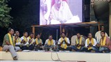 Devotees from Bodeli sing kirtans before Swamishri