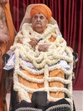Swamishri is honored with a flower shawl