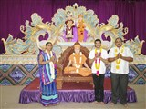 A sadhak with his parents before diksha ceremony