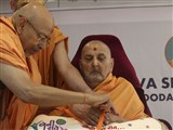 Swamishri sanctifying the Shibir ID badge