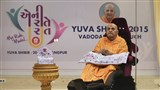 Shri Harikrishna Maharaj and Swamishri at the start of the Yuva Shibir-2015, Vadodara and Bharuch, 'My Role Model - Eni Reetey Reet'
