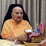 Swamishri offers Ice-cream to Thakorji