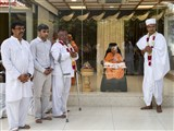 Swamishri with the newly initiated parshad and his family members