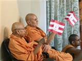 Pujya Tyagvallabh Swami and Pujya Viveksagar Swami wave BAPS flags