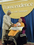 Dr. Kalam presents the book to Shri Harikrishna Maharaj and Swamishri