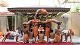 Sadhus and parshads perform yogasanas (yogic exercises) before Swamishri, on the occasion of International Yoga Day