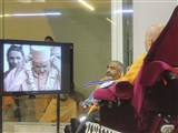 Swamishri observes a video from the London celebrations