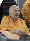 Swamishri on a tour of the mandir campus