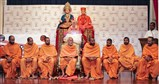 Pujya Mahant Swami and sadhus on stage during satsang assembly