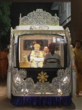 Swamishri in a decorated Rath (chariot)
