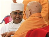 Swamishri gives diksha mantra to the newly initiated parshad and blesses him