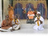 A newly initiated parshad and family members with Swamishri