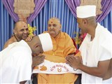 Swamishri blesses the newly initiated parshads