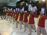 Youths from Surat perform a cultural dance before Swamishri