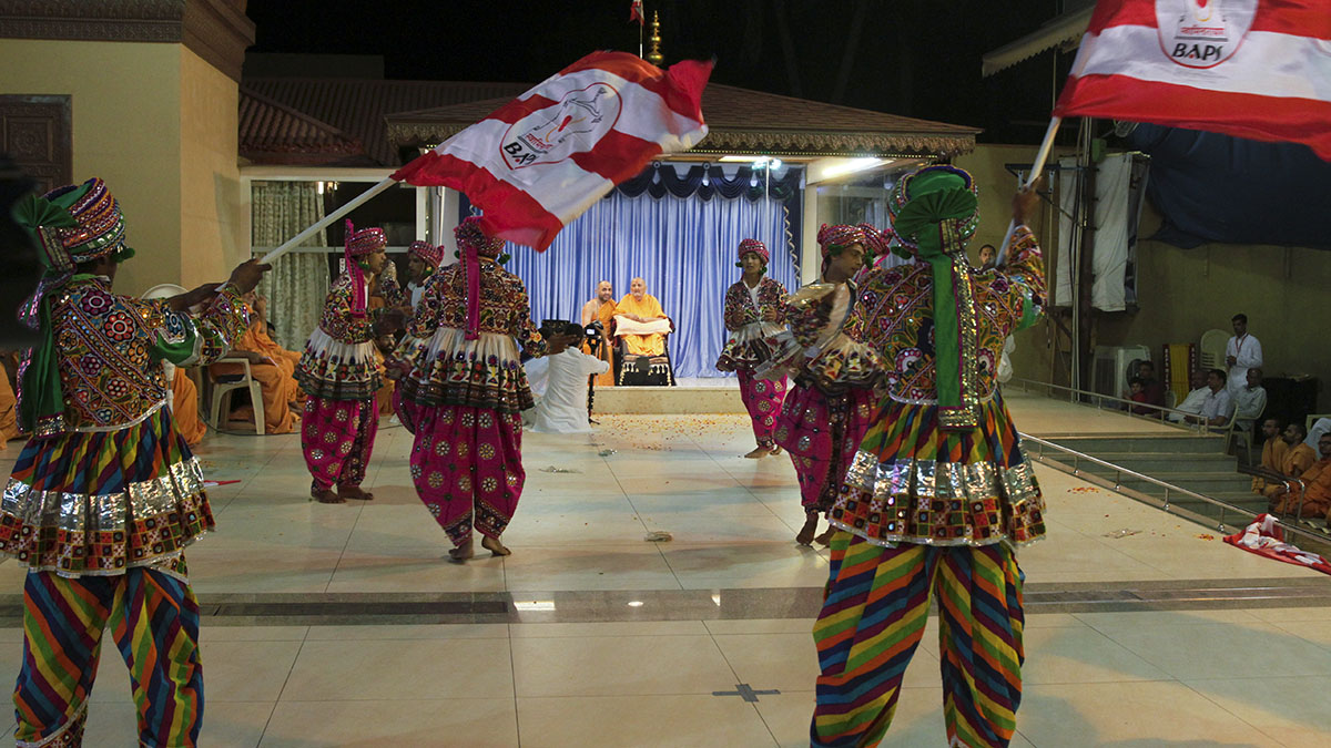 BAPS youths from Tithal perform a cultural dance before Swamishri