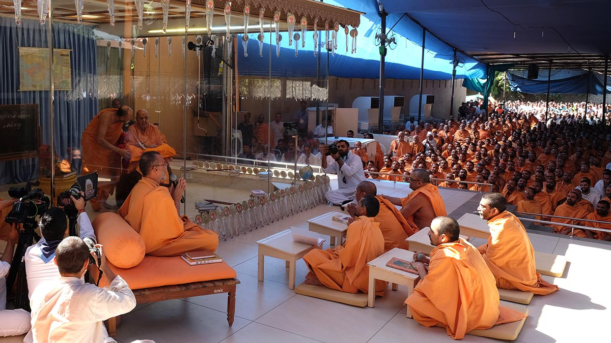 As part of Dhanurmas presentations, sadhus re-create a class of the Sanskrit Pathshala in Sarangpur before Swamishri