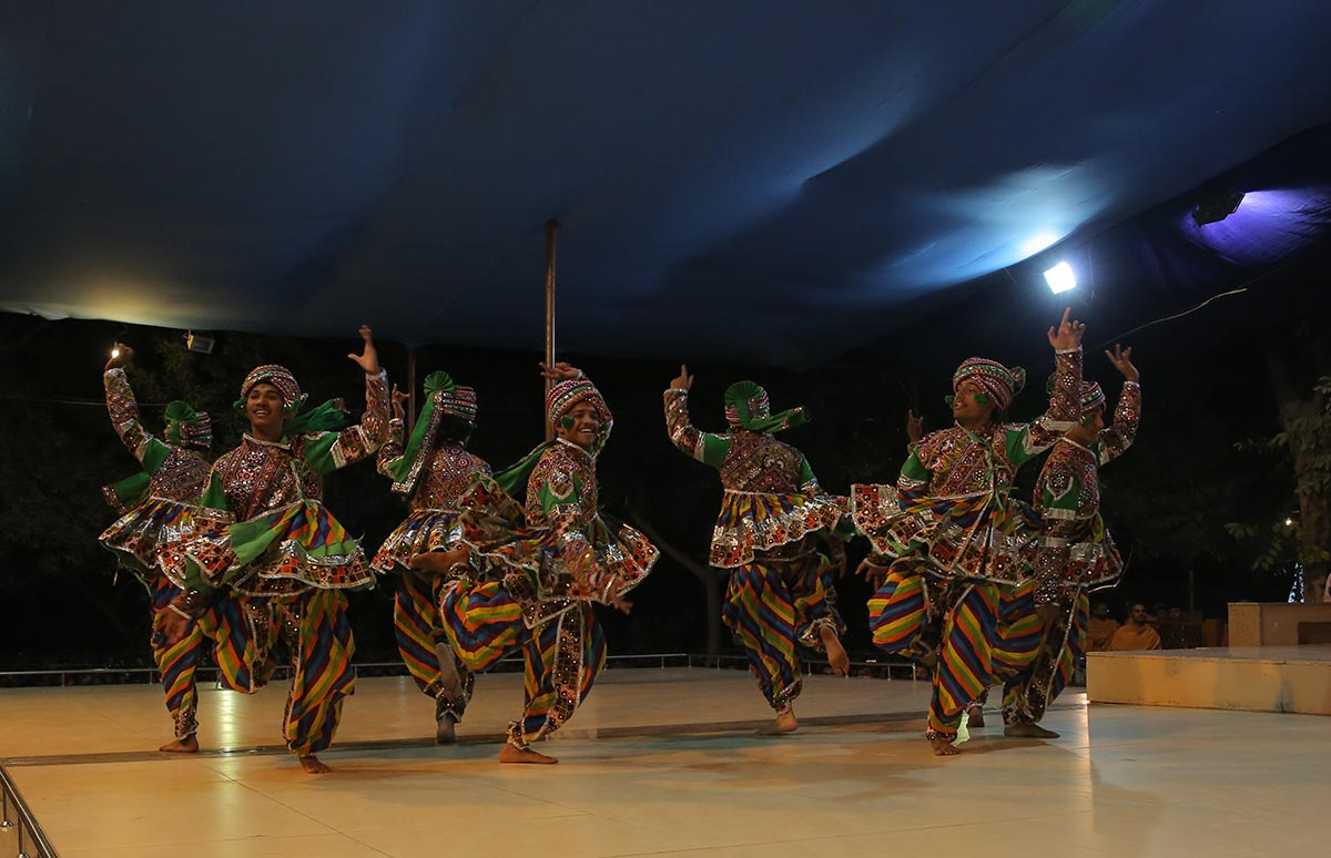 Youths perform a cultural dance
