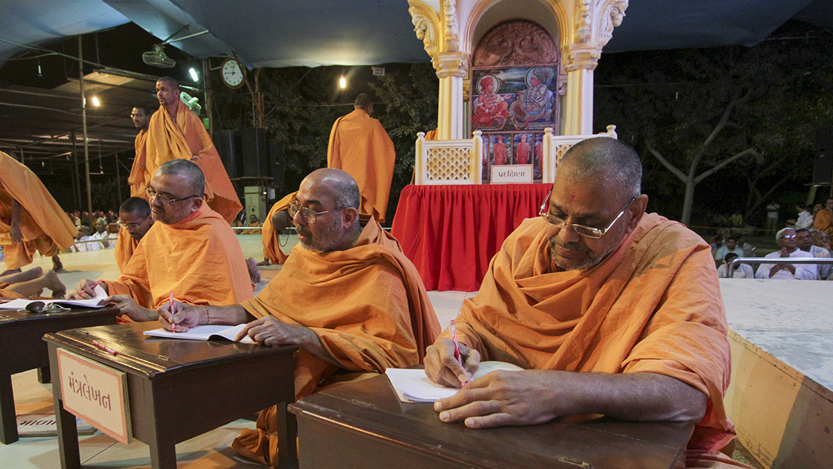 Sadhus participate in Mantra Lekhan Yagna - writing and meditating on the Swaminarayan mantra
