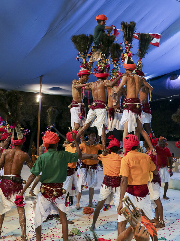 Tribal devotees perform before Swamishri