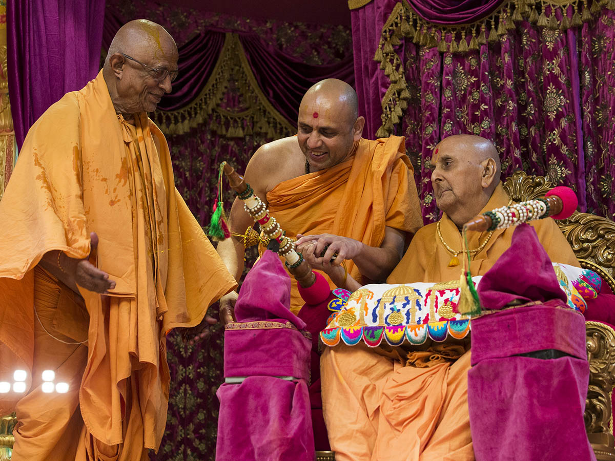Swamishri showers sanctified colored water on Pujya Doctor Swami