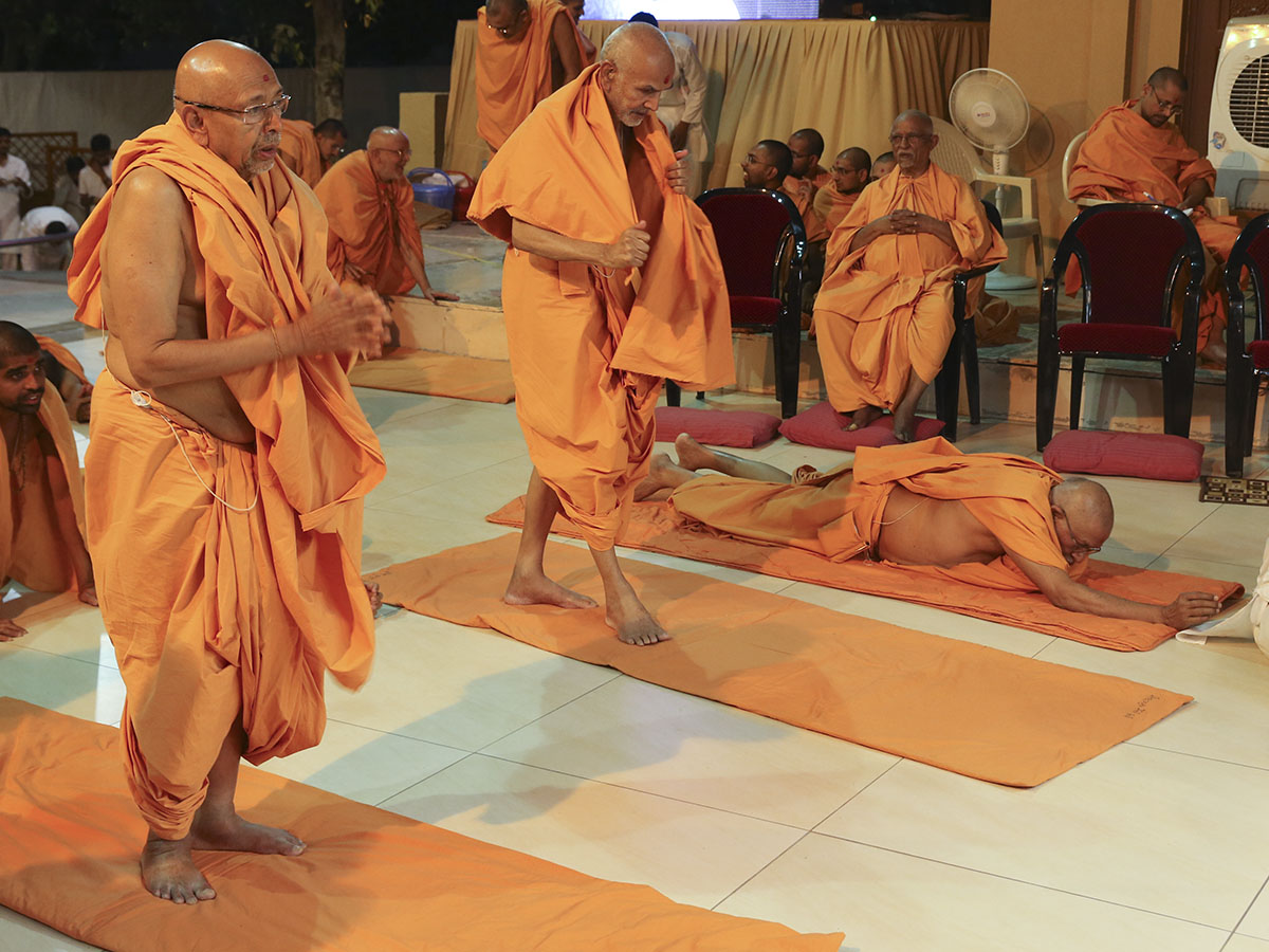Senior sadhus doing prostrations to Thakorji