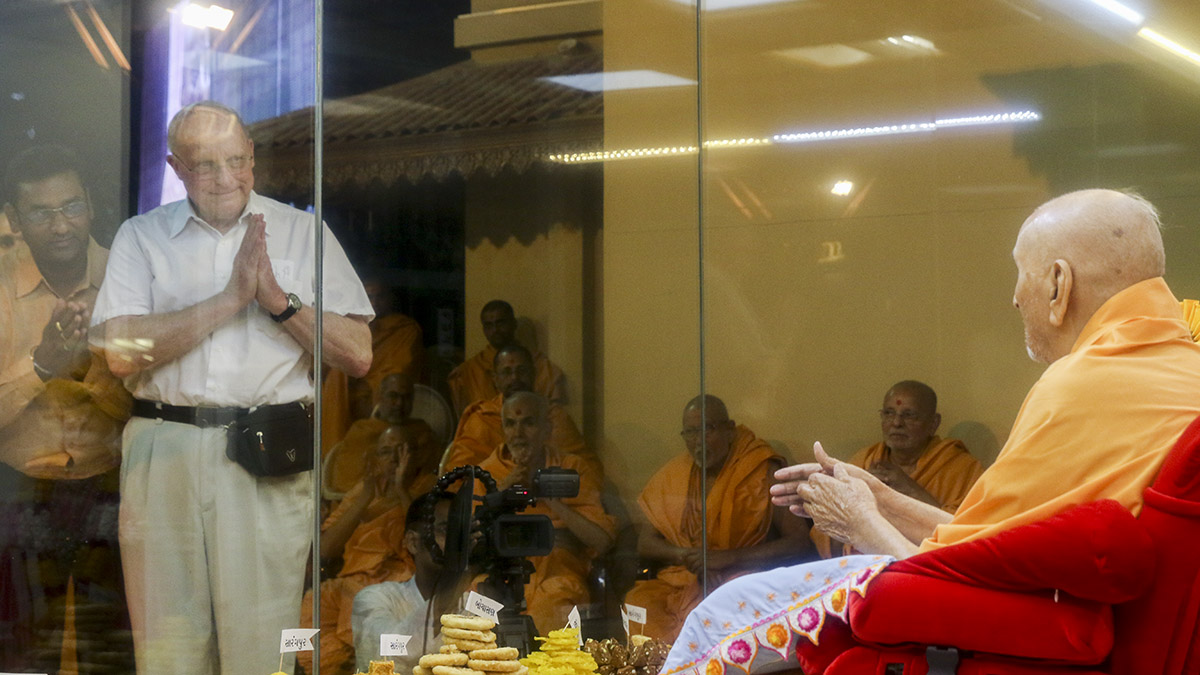 Swamishri blesses Prof. Raymond Brady Williams