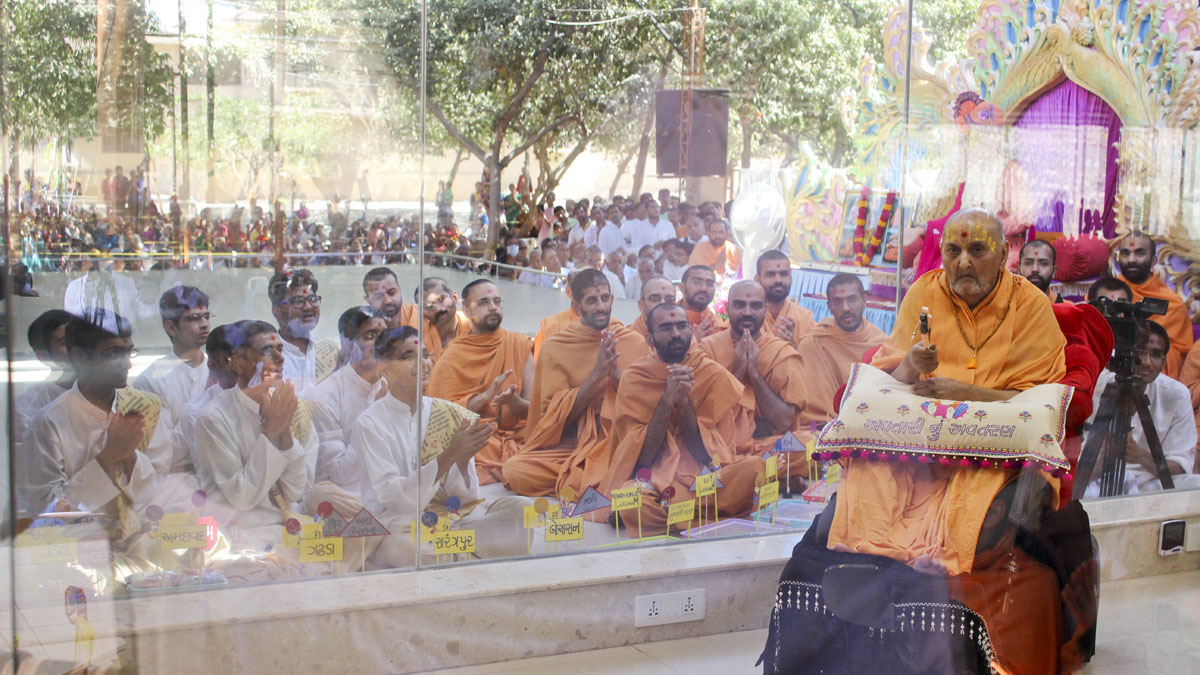 Swamishri with sadhus and youths doing Sanskrit studies