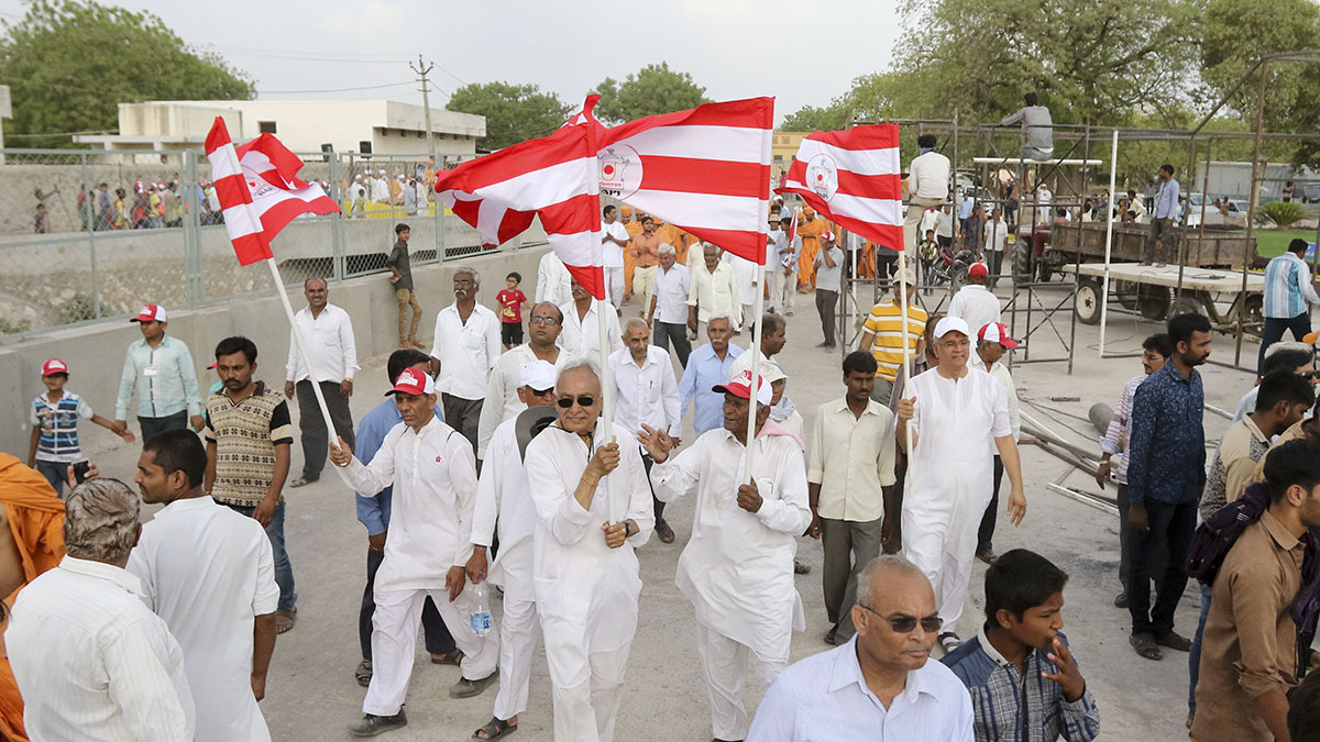 Nagar Yatra - Devotees participate in the procession with BAPS flags