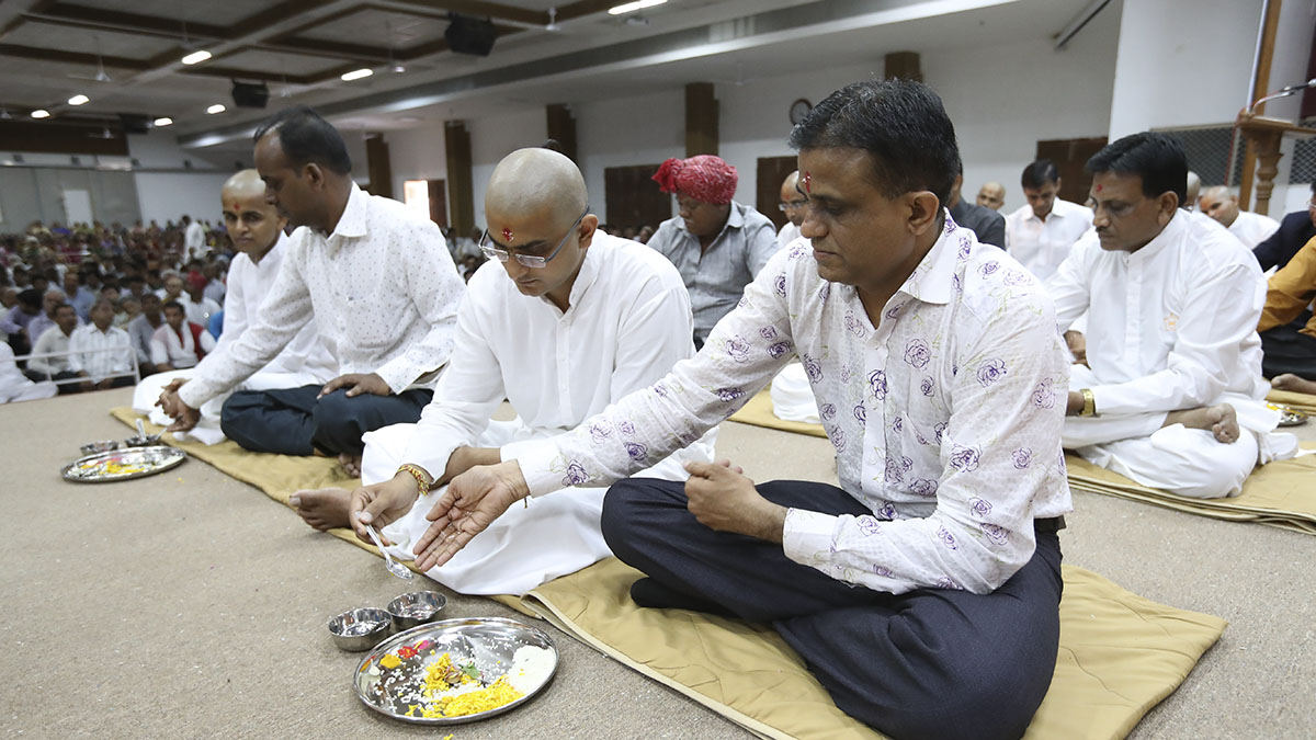 Sadhaks and their fathers engaged in mahapuja rituals