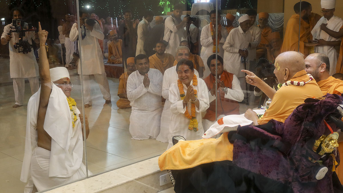 Swamishri with a newly initiated parshad and his father and relatives