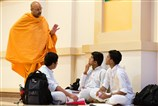 A Swami guides the delegates in their group discussion