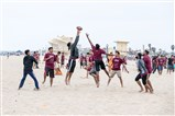 Delegates play sports on the beach