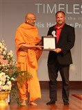 Township of Robbinsville, Council President Ron Witt presents a resolution honoring Pramukh Swami Maharaj to Pujya Yagnavallabh Swami