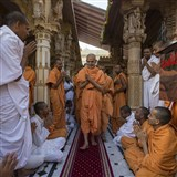 Sadhus and parshads doing darshan of Param Pujya Mahant Swami in the mandir pradakshina