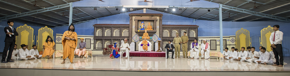 A skit presentation by youths before Param Pujya Mahant Swami in the evening assembly, 3 Oct 2016