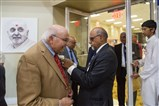Dr. Virendra Mathur, MD welcomed by a BAPS volunteer.