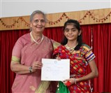 Haley Soni, Gold Medalist of Satsang Vihar 1, being felicitated.