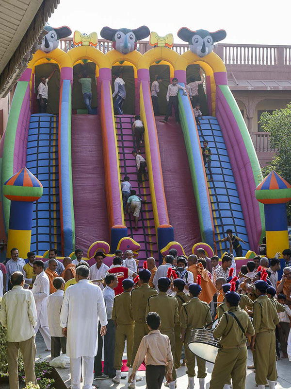 Children play on the bouncing castle, 18 Oct 2016