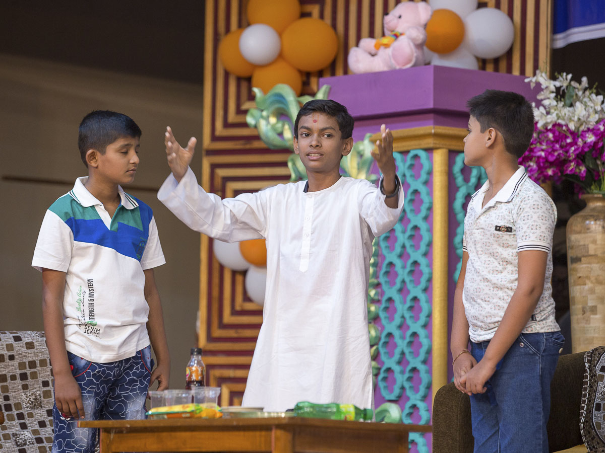 A skit presentation by children before Param Pujya Mahant Swami Maharaj in the evening satsang assembly, 21 Dec 2016