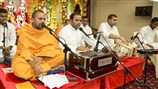 Sadhus and youths sing kirtans in the satsang assembly