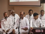 Devotees sing kirtans in the shibir