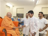Pujya Tyagvallabh Swami gives prasad to youths