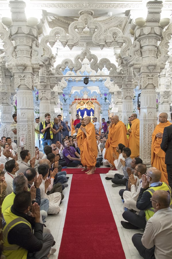 Swamishri doing darshan of the various khands in the main mandir