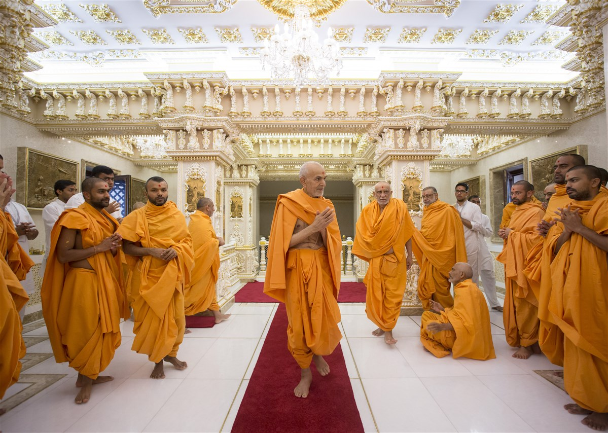 Swamishri greets the sadhus with folded hands