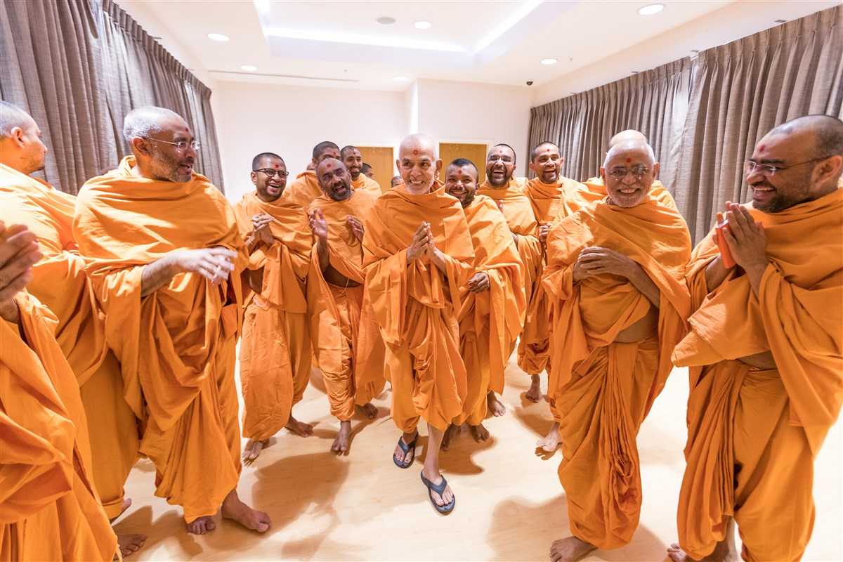 Param Pujya Mahant Swami Maharaj in a jovial mood while interacting with Pujya Swamis