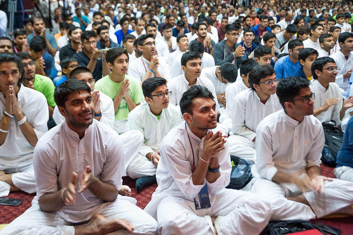 Devotees engaged in the evening arti