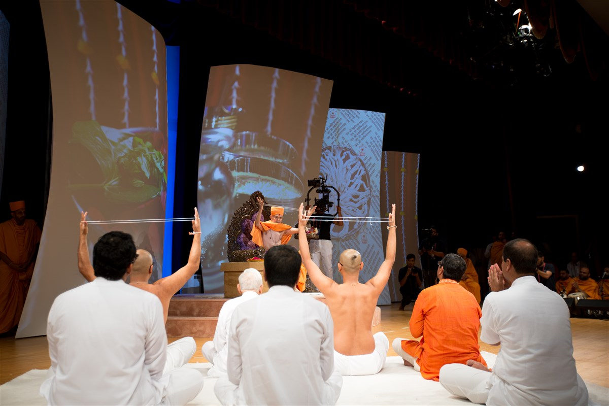 Swamishri and the two youths engaged in the diksha ceremony, 2 July 2017