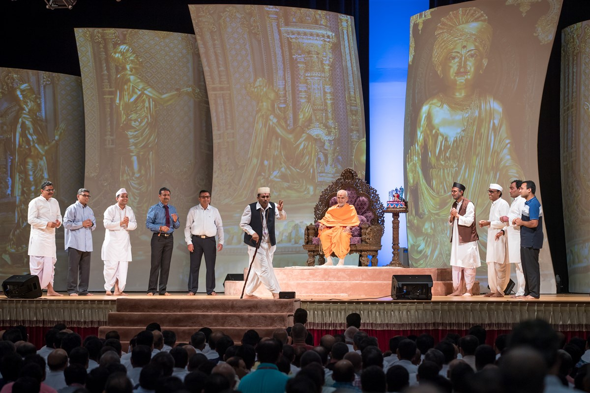 Devotees perform a skit before Swamishri, 3 July 2017