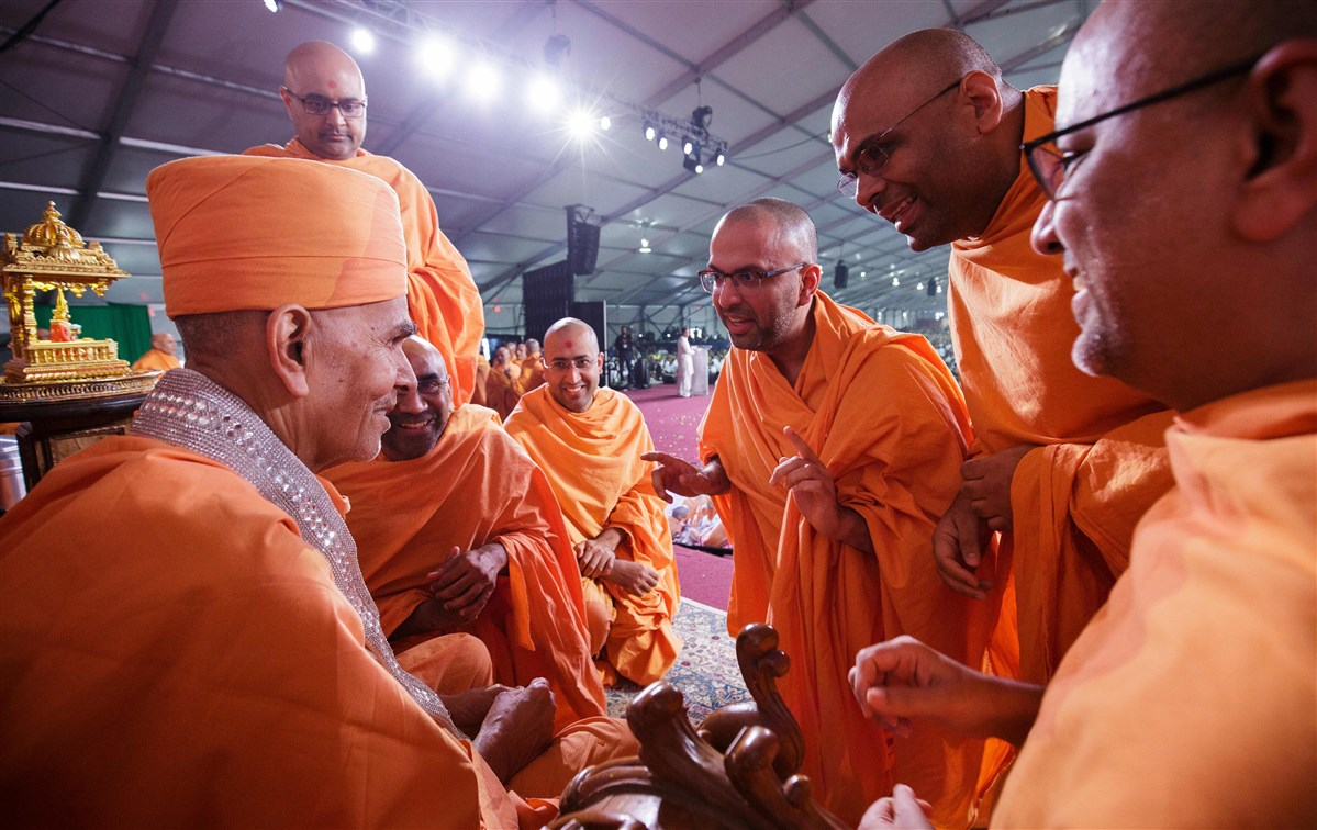 Swamis garland Mahant Swami Maharaj on the occasion of Guru Purnima