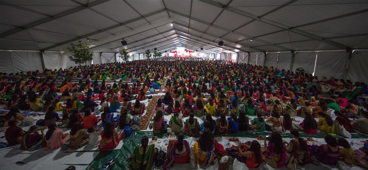 Devotees engrossed in the mahapuja rituals